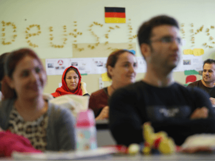 BERLIN, GERMANY - NOVEMBER 11: Recently-arrived immigrants, including from countries such as Iraq, Afghanistan and Iran, attend a first orientation class for asylum applicants whose chances of receiving longer-term asylum are slim at a classroom of the Johanniter charity on November 11, 2016 in Berlin, Germany. Germany has taken in …
