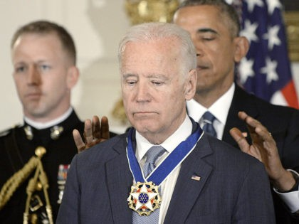 WASHINGTON, DC - JANUARY 12: (AFP OUT) U.S. President Barack Obama (R) presents the Medal of Freedom to Vice-President Joe Biden during an event in the State Dining room of the White House, January 12, 2017 in Washington, DC. (Photo by Olivier Douliery-Pool/Getty Images)