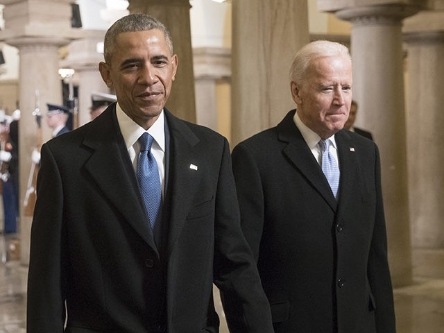 WASHINGTON, DC - JANUARY 20: President Barack Obama and Vice President Joe Biden walk through the Crypt of the Capitol for Donald Trump's inauguration ceremony, in Washington, January 20, 2017. (Photo by J. Scott Applewhite - Pool/Getty Images)