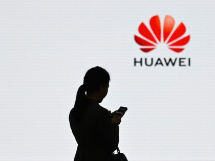 A staff member of Huawei uses her mobile phone at the Huawei Digital Transformation Showcase in Shenzhen, China's Guangdong province on March 6, 2019. - Chinese telecom giant Huawei insisted on March 6 its products feature no security 'backdoors' for the government, as the normally secretive company gave foreign media …