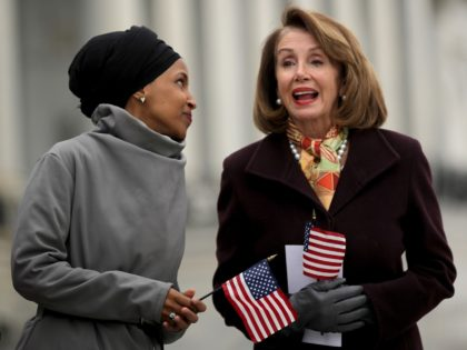 WASHINGTON, DC - MARCH 08: Rep. Ilhan Omar (D-MN) (L) talks with Speaker of the House Nancy Pelosi (D-CA) during a rally with fellow Democrats before voting on H.R. 1, or the People Act, on the East Steps of the U.S. Capitol March 08, 2019 in Washington, DC. With almost …