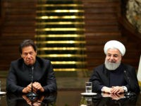 In this photo released by the official website of the office of the Iranian Presidency, President Hassan Rouhani, right, and Pakistani Prime Minister Imran Khan, attend a joint press briefing, after their meeting at the Saadabad Palace in Tehran, Iran, Monday, April 22, 2019. (Iranian Presidency Office via AP)