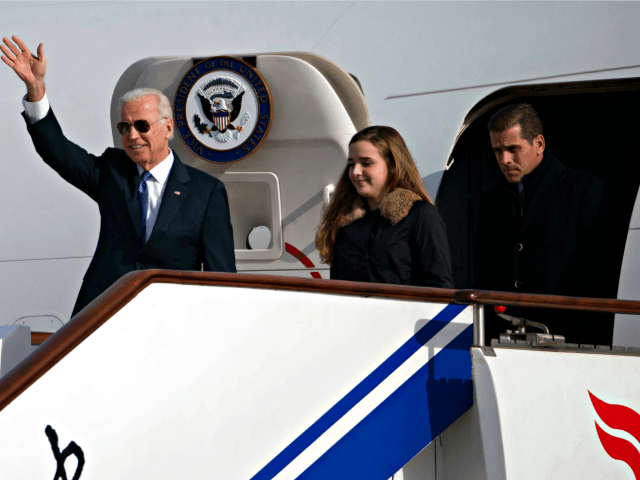 This Dec. 4, 2013, file photo shows U.S. Vice President Joe Biden, left, arriving on Air Force Two in Beijing, China, with his son Hunter Biden, right, and his granddaughter Finnegan Biden. As the Vice President travels to Ukraine Saturday, June 7, 2014, his youngest son, Hunter, 44, has been …