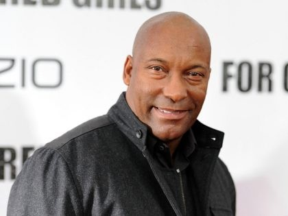 """NEW YORK - OCTOBER 25: John Singleton attends the premiere of """"For Colored Girls"""" at Ziegfeld Theatre on October 25, 2010 in New York City. (Photo by Stephen Lovekin/Getty Images)"""