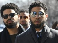 """Empire"" actor Jussie Smollett, center, arrives at Leighton Criminal Court Building for a hearing to discuss whether cameras will be allowed in the courtroom during his disorderly conduct case on Tuesday, March 12, 2019, in Chicago. A grand jury indicted Smollett last week on 16 felony counts accusing him of …"