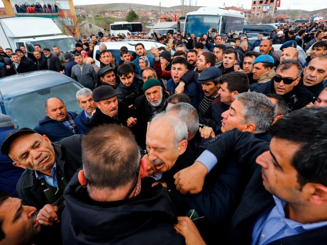 The Chairman of the Republican People's Party (CHP) Kemal Kilicdaroglu (C) is attacked by a protester on April 21, 2019 while attending a funeral ceremony in Ankara's Cubuk district for a soldier killed in fighting against Kurdish militants. - The CHP last month won Ankara and Istanbul mayors' offices in …