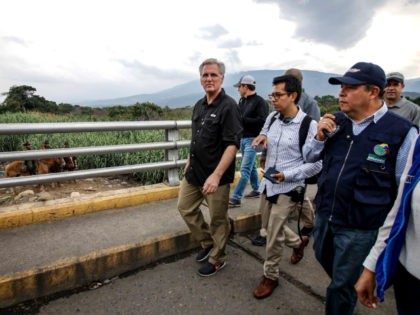 U.S. House Minority Leader Kevin McCarthy (R) walks over the Simon Bolivar International Bridge in Cucuta, Colombia in the border with Venezuela, on April 18, 2019. (Photo by Schneyder MENDOZA / AFP) (Photo credit should read SCHNEYDER MENDOZA/AFP/Getty Images)