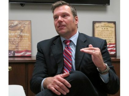 In this Oct. 16, 2017, file photo, Kansas Secretary of State Kris Kobach answers questions about his run for the Republican nomination for governor during an interview at the Johnson County Republican Party's headquarters in Overland Park, Kan. Attacks on Kobach by the American Civil Liberties Union in the Kansas …