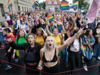 Participants of a gay pride parade walk through the streets of Poznan, August 11, 2018. (Photo by Wojtek RADWANSKI / AFP) (Photo credit should read WOJTEK RADWANSKI/AFP/Getty Images)