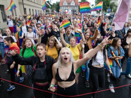 Participants of a gay pride parade walk through the streets of Poznan, August 11, 2018. (Photo by Wojtek RADWANSKI / AFP) (Photo credit should read WOJTEK RADWANSKI/AFP/Getty Images)