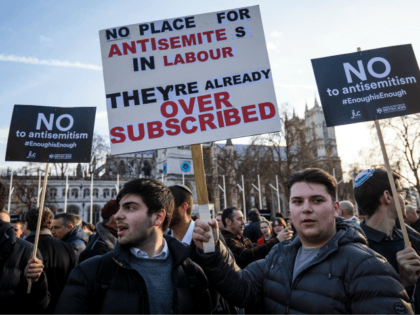 LONDON, ENGLAND - MARCH 26: Protesters hold placards as they demonstrate in Parliament Square against anti-Semitism in the Labour Party on March 26, 2018 in London, England. The Board of Deputies of British Jews and the Jewish Leadership Council have drawn up a letter accusing Labour Leader Jeremy Corbyn of …