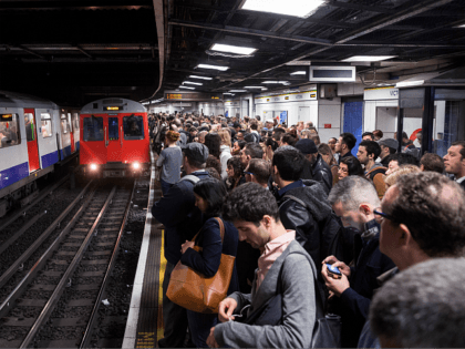 LONDON, ENGLAND - APRIL 30: Commuters prepare to travel on the District Line of the London Underground which is running a limited service due to industrial action on April 30, 2014 in London, England. At 9pm on April 28, 2014 members of the Rail, Maritime and Transport (RMT) Union commenced …