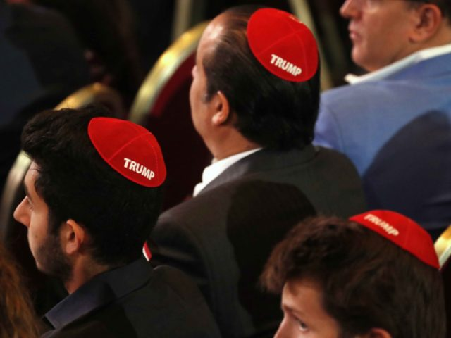 "Men attending the Republican Jewish Coalition's annual leadership meeting wear red yarmulkes with the word ""Trump"" on them, Saturday April 6, 2019, as they wait for President Donald Trump to arrive to speak in Las Vegas. (AP Photo/Jacquelyn Martin)"