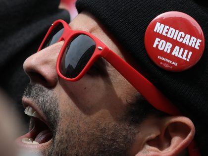 "WASHINGTON, DC - APRIL 29: Protesters supporting ""Medicare for All"" hold a rally outside PhRMA headquarters April 29, 2019 in Washington, DC. The rally was held by the group Progressive Democrats of America. (Photo by Win McNamee/Getty Images)"