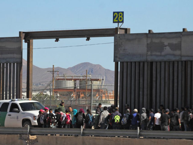 Central American migrants surrender to United States Border Patrol officers after crossing to El Paso, Texas from Ciudad Juarez, Chihuahua state, Mexico on April 21, 2019. (Photo by Herika Martinez / AFP) (Photo credit should read HERIKA MARTINEZ/AFP/Getty Images)