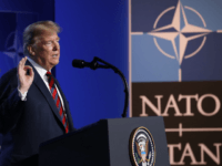 BRUSSELS, BELGIUM - JULY 12: U.S. President Donald Trump, flanked by National Security Advisor John Bolton, speaks to the media at a press conference on the second day of the 2018 NATO Summit on July 12, 2018 in Brussels, Belgium. Leaders from NATO member and partner states are meeting for …