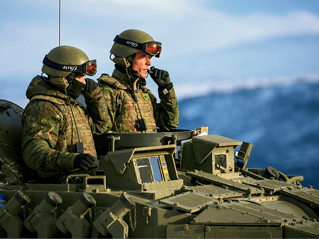 Spanish soldiers in an Pizarro tank during an exercise to capture an airfield as part of the Trident Juncture 2018, a NATO-led military exercise, on November 1, 2018 near the town of Oppdal, Norway. - Trident Juncture 2018, is a NATO-led military exercise held in Norway from 25 October to …