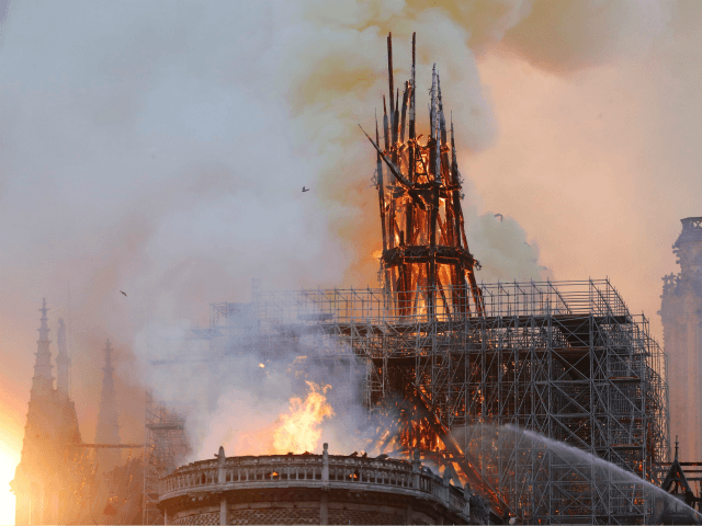 Smoke and flames rise during a fire at the landmark Notre-Dame Cathedral in central Paris on April 15, 2019, potentially involving renovation works being carried out at the site, the fire service said. - A major fire broke out at the landmark Notre-Dame Cathedral in central Paris sending flames and huge clouds of grey smoke billowing into the sky, the fire service said. The flames and smoke plumed from the spire and roof of the gothic cathedral, visited by millions of people a year, where renovations are currently underway. (Photo by FRANCOIS GUILLOT / AFP) (Photo credit should read FRANCOIS GUILLOT/AFP/Getty Images)