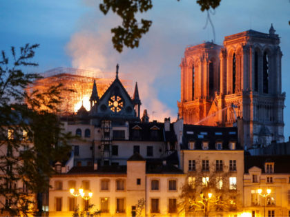 Parisians Sing Hymns as Notre Dame Cathedral Is Engulfed in Flames