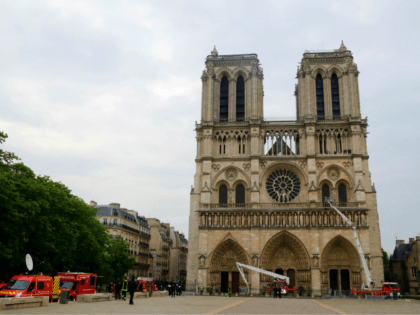 Firefighters secure Notre-Dame Cathedral in Paris on April 16, 2019, in the aftermath of a fire that caused its spire to crash to the ground. - Crowds of stunned Parisians and tourists -- some crying, others offering prayers -- watched in horror in central Paris on April 15 night as …