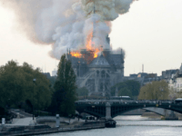 TOPSHOT - Smokes ascends as flames rise during a fire at the landmark Notre-Dame Cathedral in central Paris on April 15, 2019 afternoon, potentially involving renovation works being carried out at the site, the fire service said. (Photo by FRANCOIS GUILLOT / AFP) (Photo credit should read FRANCOIS GUILLOT/AFP/Getty Images)