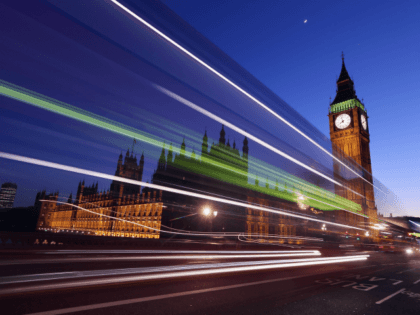 LONDON, ENGLAND - MARCH 27: A bus travels along Westminster Bridge past the Houses of Parliament on March 27, 2012 in London, England. (Photo by Oli Scarff/Getty Images)