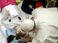 Pope Francis bends to kiss a child participating into a public audience to patients and employees of Rome's pediatric hospital Bambino Gesu, held in the Paul VI hall at the Vatican, Thursday, Dec. 15, 2016. (AP Photo/Alessandra Tarantino)