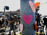Hand-written notes are displayed on a light post across the street from the Chabad of Poway Synagogue after a shooting on April 27, 2019 in Poway, California. - A gunman opened fire at a synagogue in California, killing one person and injuring three others including the rabbi as worshippers marked …