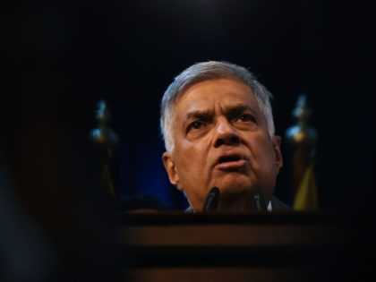 Sri Lanka's Prime Minister Ranil Wickremesinghe speaks to supporters at the prime minister's official residence in Colombo on December 16, 2018. - Sri Lanka's president on December 16 reappointed as prime minister the same man he sacked from the job nearly two months ago, ending a messy power struggle that …