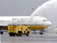 AUCKLAND, NEW ZEALAND - OCTOBER 28: The Royal Brunei Airlines aircraft gets a water send off from two fire trucks as it departs Auckland International Airport, Tuesday. (Photo by Dean Purcell/Getty Images)