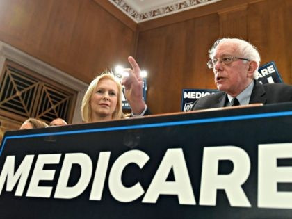 """Sen. Bernie Sanders, I-Vt., right, speaks during a news conference on Capitol Hill in Washington, Wednesday, April 10, 2019, to reintroduce his """"Medicare for All"""" legislation to create a government-run health insurance plan. Sanders is joined by Sen. Kirsten Gillibrand, D-N.Y., left. (AP Photo/Susan Walsh)"""