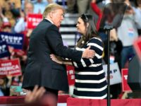US President Donald Trump (L) embraces White House Press Secretary Sarah Huckabee Sanders during a Make America Great Again rally in Green Bay, Wisconsin, April 27, 2019. (Photo by SAUL LOEB / AFP) (Photo credit should read SAUL LOEB/AFP/Getty Images)