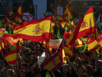 MADRID, SPAIN - APRIL 26: Supporters of far right wing party VOX wave Spanish and Vox flags in the air during the VOX closing rally on April 26, 2019 in Madrid, Spain. Spaniards go to the polls to elect 350 members of the parliament and 208 senators this Sunday. This …