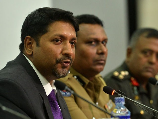 Sri Lanka's state minister of defence Ruwan Wijewardene (L) speaks during a press conference in Colombo on April 24, 2019. - A Sri Lankan security dragnet hunting those responsible for horrifying bombings that claimed more than 350 lives has scooped up a further 18 suspects, police said April 24, as …