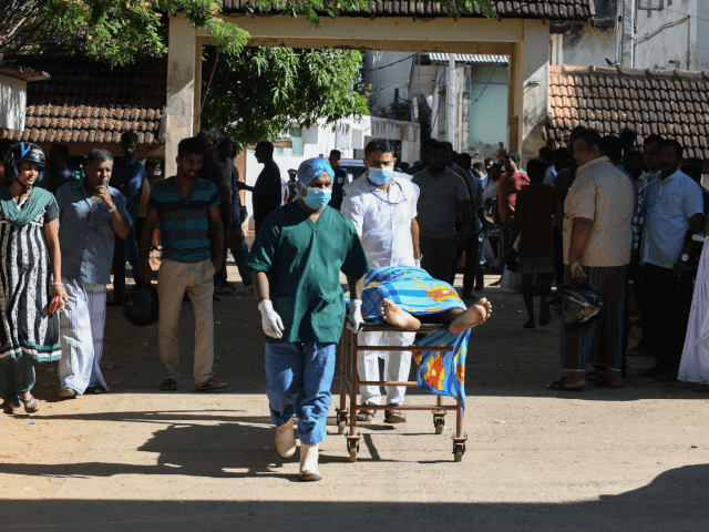 Graphic content / Sri Lankan hospital workers transport a body on a trolley at a hospital morgue following an explosion at a church in Batticaloa in eastern Sri Lanka on April 21, 2019. - A series of eight devastating bomb blasts ripped through high-end hotels and churches holding Easter services …