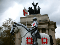 LONDON, ENGLAND - APRIL 22: A 15 foot high statue of St George astride a horse is unveiled at Wellington Arch on April 22, 2015 in London, United Kingdom. The statue's unveiling marks the launch of a nationwide tour to celebrate St George's Day and will see the knight open …