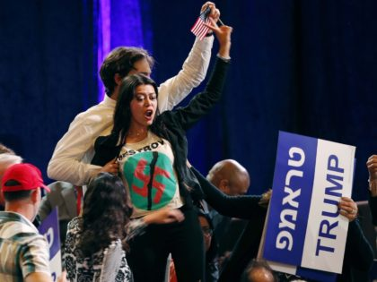 A woman protests as President Donald Trump speaks at an annual meeting of the Republican Jewish Coalition, Saturday, April 6, 2019, in Las Vegas. (AP Photo/John Locher)