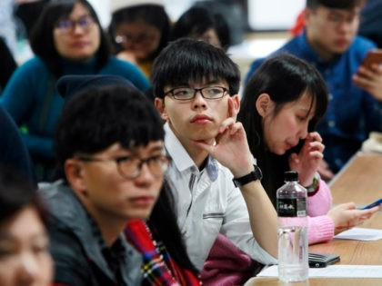 Hong Kong pro-democracy student leader Joshua Wong, center, listens to speakers during a democracy forum in Taipei, Taiwan, Thursday, Jan. 14, 2016. Taiwan will hold its presidential elections on Jan. 16, 2016. (AP Photo/Chiang Ying-ying)