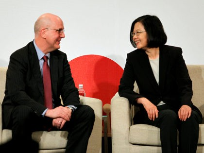 Taiwan's President Tsai Ing-wen, right, talks to David Meale, Deputy Assistant Secretary at U.S. Department of State during the 2019 Hsieh Nien Fan annual dinner of the American Chamber of Commerce in Taipei, Taiwan, Wednesday, April 10, 2019. (AP Photo/Chiang Ying-ying)