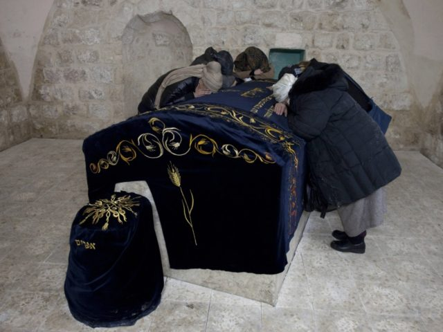 Jewish women and settlers pray at the Tomb of Joseph, a biblical figure from the book of Genesis, in the northern Palestinian West Bank city of Nablus, on February 16, 2012 as few hundreds religious Jews were allowed by the Israeli army to enter the Palestinian territory, in a heavily …