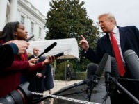 CNN journalist Abby Phillip asks President Donald Trump a question as he speaks with reporters before departing for France on the South Lawn of the White House, Friday, Nov. 9, 2018, in Washington. (AP Photo/Evan Vucci)