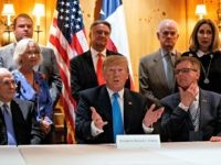President Donald Trump speaks with reporters about border policy during a fundraising event, Wednesday, April 10, 2019, in San Antonio. (AP Photo/Evan Vucci)