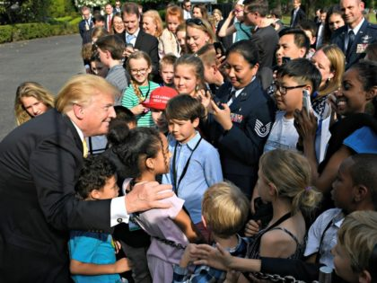 President Donald Trump greets children after speaking to them on the South Lawn of the White House in Washington, Thursday, April 25, 2019, as part of the activities for Take Our Daughters and Sons to Work Day at the White House. (AP Photo/Susan Walsh)