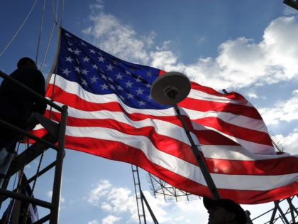 US aircraft carrier USS George Washington crew hoist the national flag during the 'Keen Sword', a US-Japan military exercise at the Pacific Ocean on December 10, 2010. The eight-day-long exercise which started on Decomber 3 ends on December 10 as around 10,500 US service members and their Japanese Self Defence …