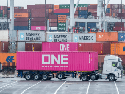 SOUTHAMPTON, ENGLAND - NOVEMBER 20: A lorry passes shipping containers that are stacked at Southampton Docks on November 20, 2018 in Southampton, England. As the date for the UKs departure from the European Union approaches, uncertainty still remains regarding the future trading relationship and how this will affect exports and …