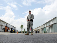 A US soldier stands in front of the housing buiding at the new European headquarters of the US Army Europe.