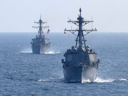 The guided-missile destroyers USS Forrest Sherman (DDG 98), right, and USS Arleigh Burke (DDG 51) transit the Atlantic Ocean in formation while participating in dual-carrier sustainment operations with the Nimitz-class aircraft carriers USS Harry S. Truman (CVN 75) and USS Abraham Lincoln (CVN 72). In addition to demonstrating the Navy's …