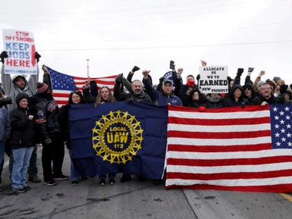 General Motors workers cheer for support outside the plant, Wednesday, March 6, 2019, in Lordstown, Ohio. General Motors' sprawling Lordstown assembly plant near Youngstown is ending production of the Chevrolet Cruze sedan, ending for now more than 50 years of auto manufacturing at the site. (AP Photo/Tony Dejak)