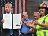 US President Donald Trump signs executive orders on energy and infrastructure at the International Union of Operating Engineers International Training and Education Center in Crosby, Texas, on April 10, 2019. Credit: JIM WATSON/AFP/Getty Images