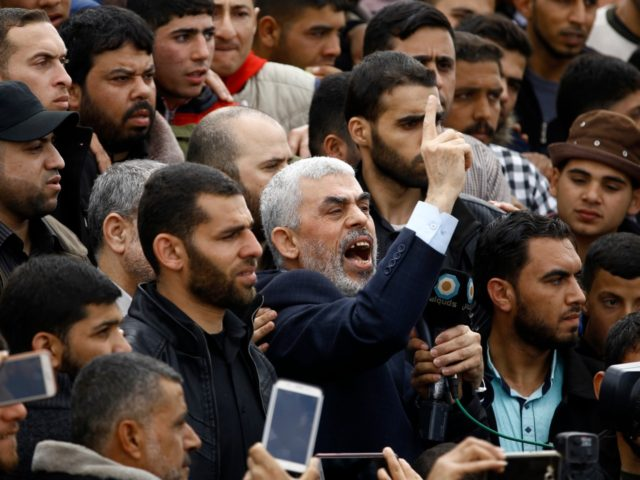 Islamist Hamas movement leader Yahya Sinwar (C) shouts slogans as he takes part in a tent city protest near the border with Israel east of Jabalia in the northern Gaza strip on March 30, 2018 to commemorate Land Day. Land Day marks the killing of six Arab Israelis during 1976 …